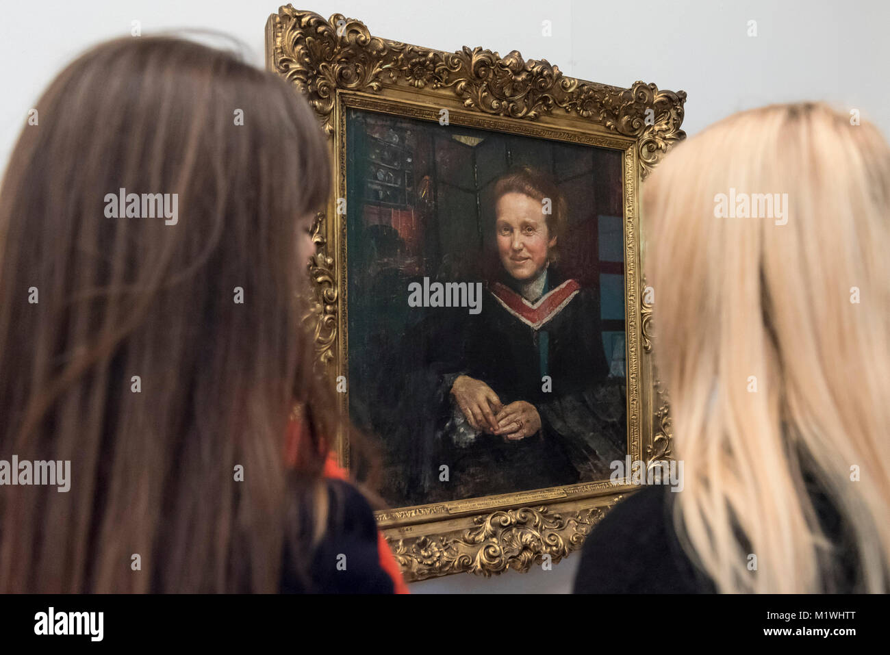 London, UK. 2nd Feb, 2018. Staff members view a portrait of Millicent Fawcett, by Annie Swynnerton, on display at - Stock Image