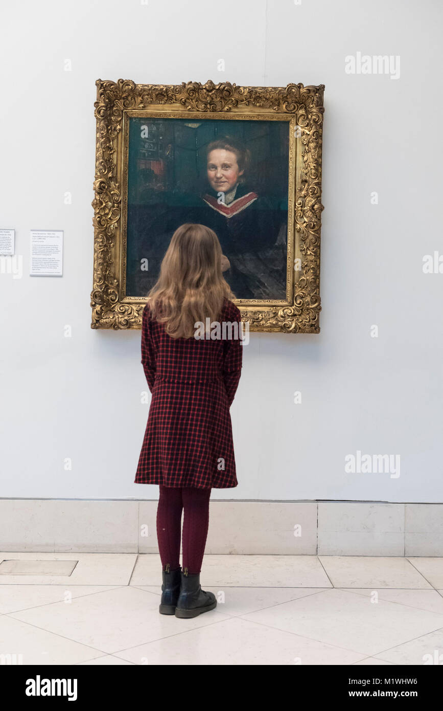 London, UK. 2nd Feb, 2018. Stella Cartwright, aged 9, views a portrait of Millicent Fawcett, by Annie Swynnerton, - Stock Image