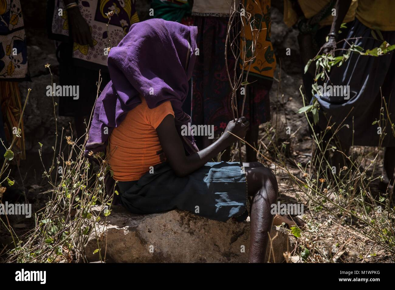 Karamoja, Uganda. 31st Jan, 2018. A young girl takes part in a reenaction of the ceremony Pokot tribal people perform - Stock Image