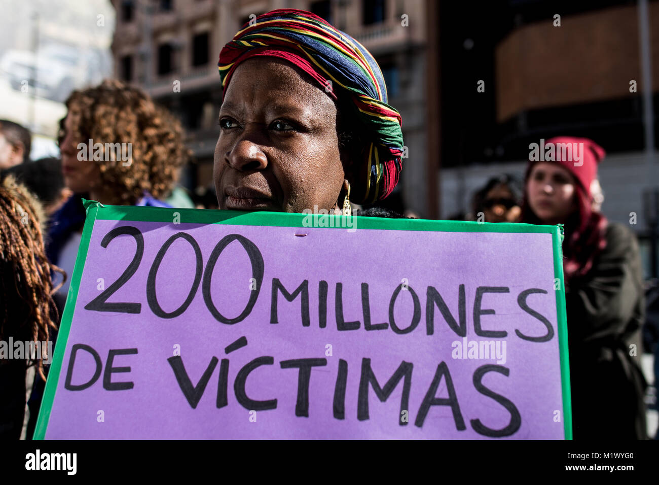 Madrid, Spain. 3rd Feb, 2018. A woman with a placard that reads '200 million victims' protesting against - Stock Image