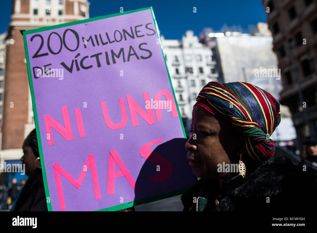 Madrid, Spain. 3rd Feb, 2018. A woman with a placard that reads '200 million victims, no one more' protesting - Stock Image