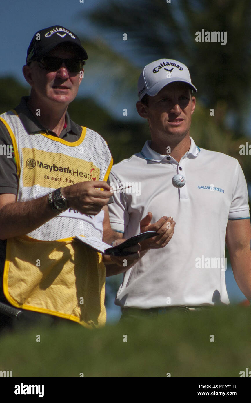 Shah Alam, Kuala Lumpur, Malaysia. 3rd Feb, 2018. Chris Paisley is seen twith his caddie on day 3 at the Maybank Stock Photo