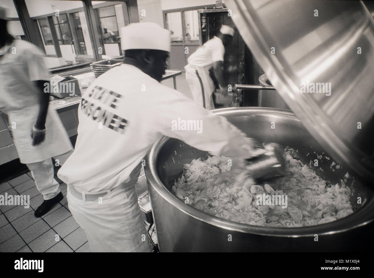 Convicts work in a prison kitchen inside a state prison in Georgia, USA. - Stock Image