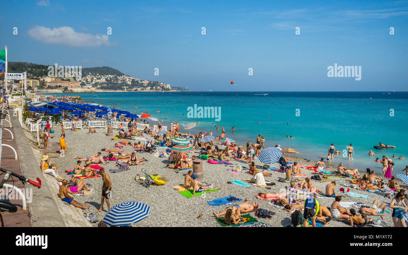 France, Alpes-Maritimes department, Côte d'Azur, Nice, sunseekers at Plage Beau Rivage, Promenade des Anglais - Stock Image