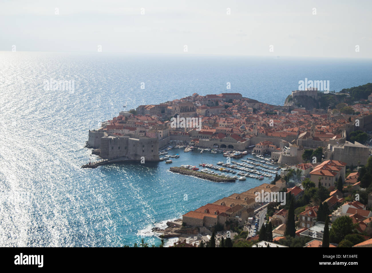 View onto Old Town of Dubrovnik with Harbor from Lookout Point, Croatia - Stock Image
