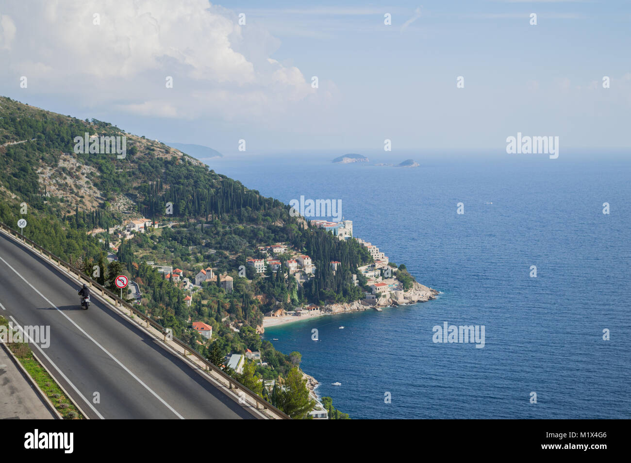 Picturesque Coastal Road with Motorcycle and View onto Dubrovnik, Croatia - Stock Image