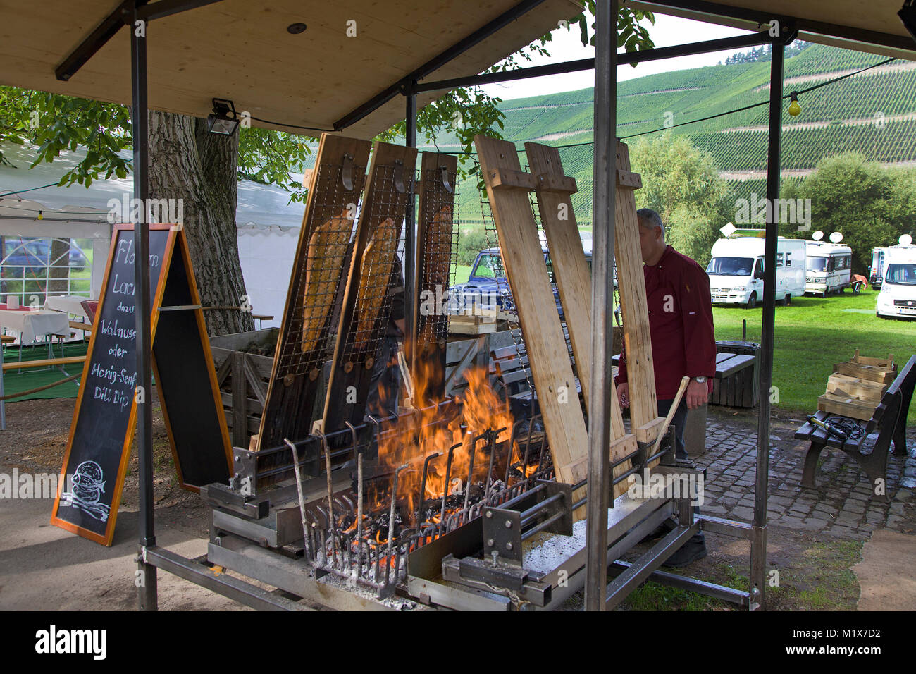Flamed salmon at a food stall, wine festival at Brauneberg, Moselle river, Rhineland-Palatinate, Germany, Europe - Stock Image
