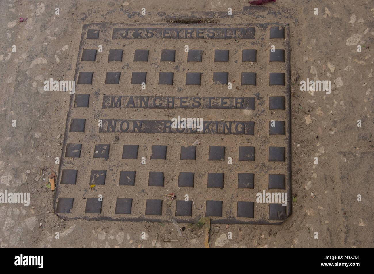 J & S Eyres Non Rocking Manchester square iron manhole cover on the street in Stone Town Zancibar City Zanzibar - Stock Image