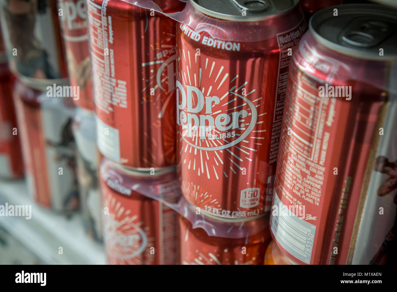 Cans of Dr. Pepper soda on a supermarket shelf in New York on Monday, January 29, 2018. JAB Holding Co.'s Keurig - Stock Image