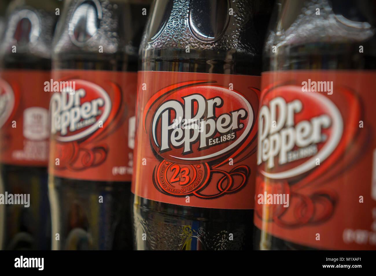 Bottles of Dr. Pepper soda on a supermarket shelf in New York on Monday, January 29, 2018. JAB Holding Co.'s - Stock Image