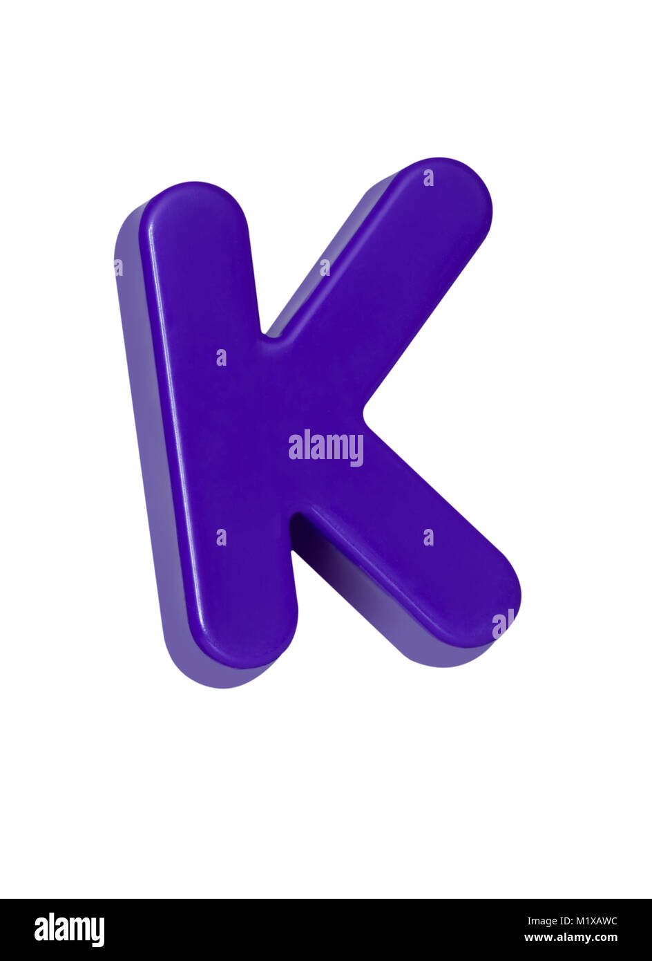 A cut out shot of a purple plastic letter 'K' - Stock Image