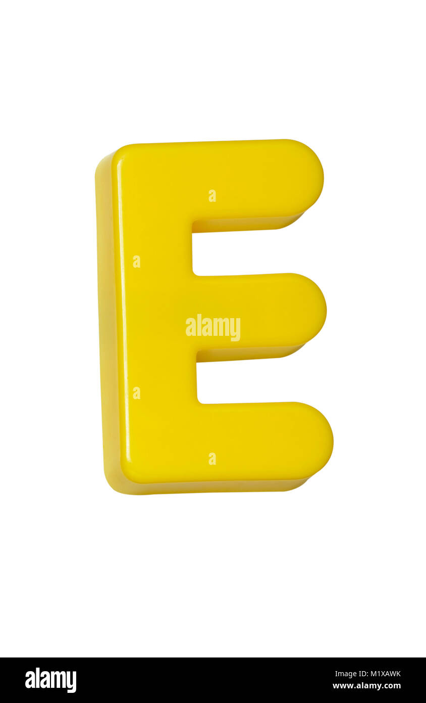 A cut out shot of a yellow plastic letter 'E' - Stock Image