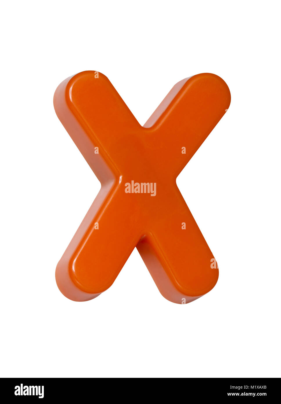 A cut out shot of an orange plastic letter 'X' - Stock Image