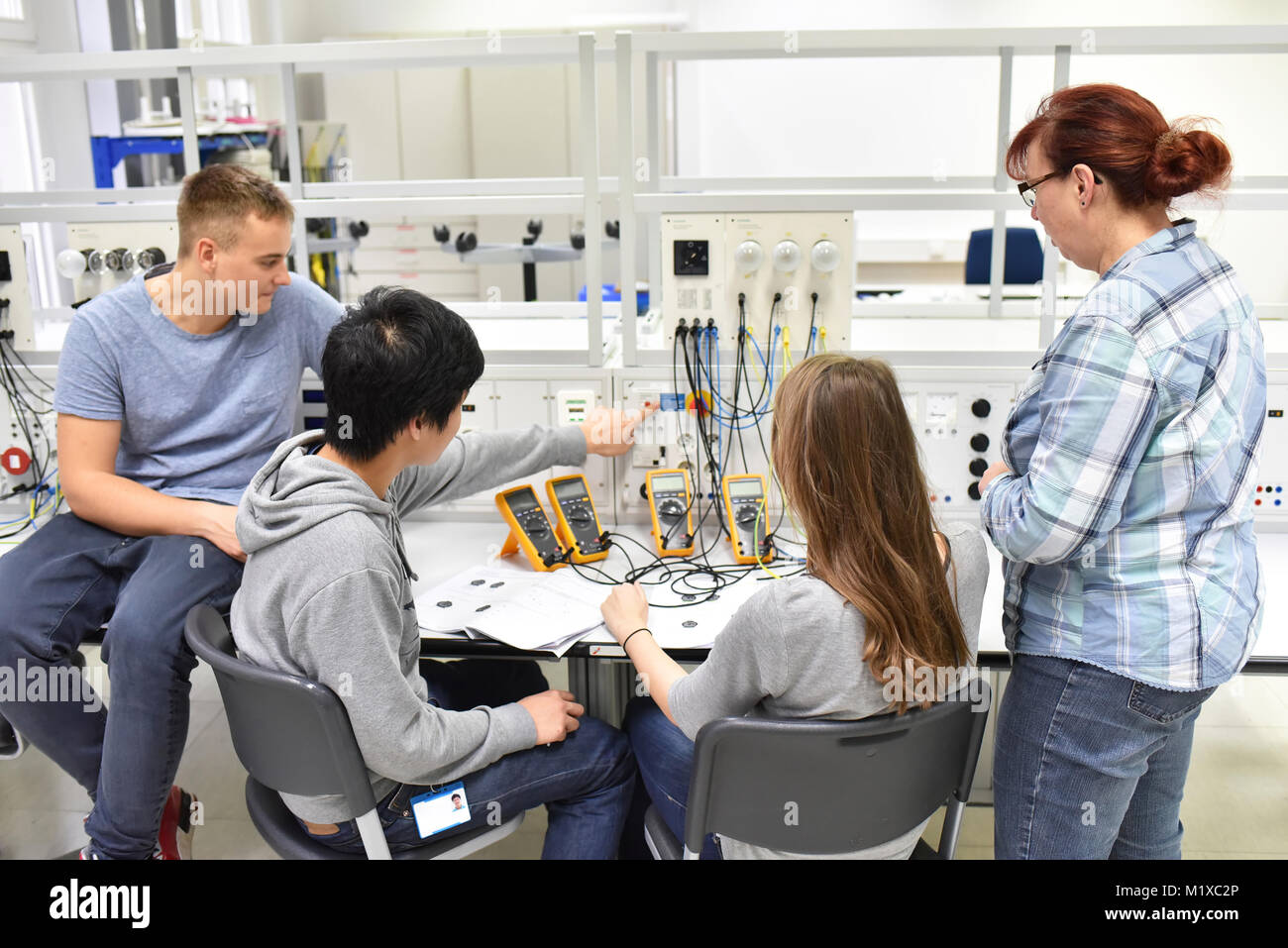 technical vocational training in industry: young apprentices and trainers in the classroom - Stock Image