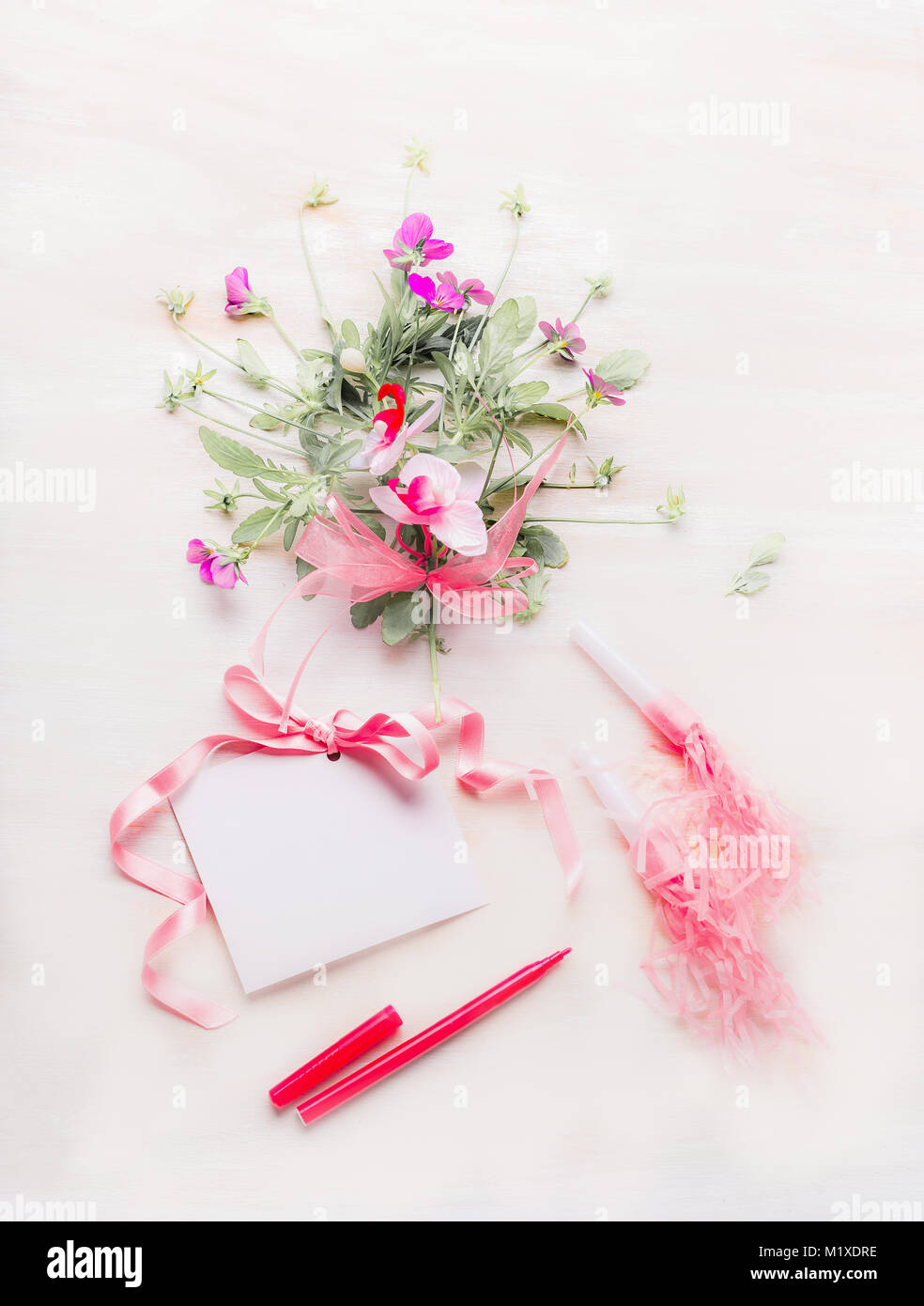 Lovely flowers bunch and blank greeting card with pink ribbon and lovely flowers bunch and blank greeting card with pink ribbon and pen or marker on white wooden background festive greeting concept mightylinksfo