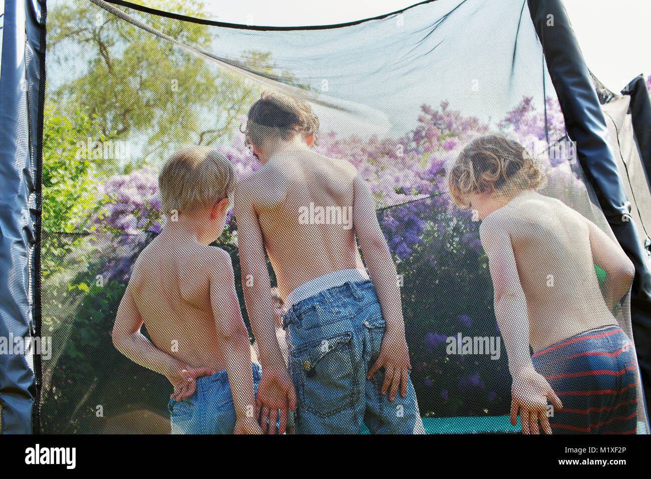 Boys on trampoline - Stock Image
