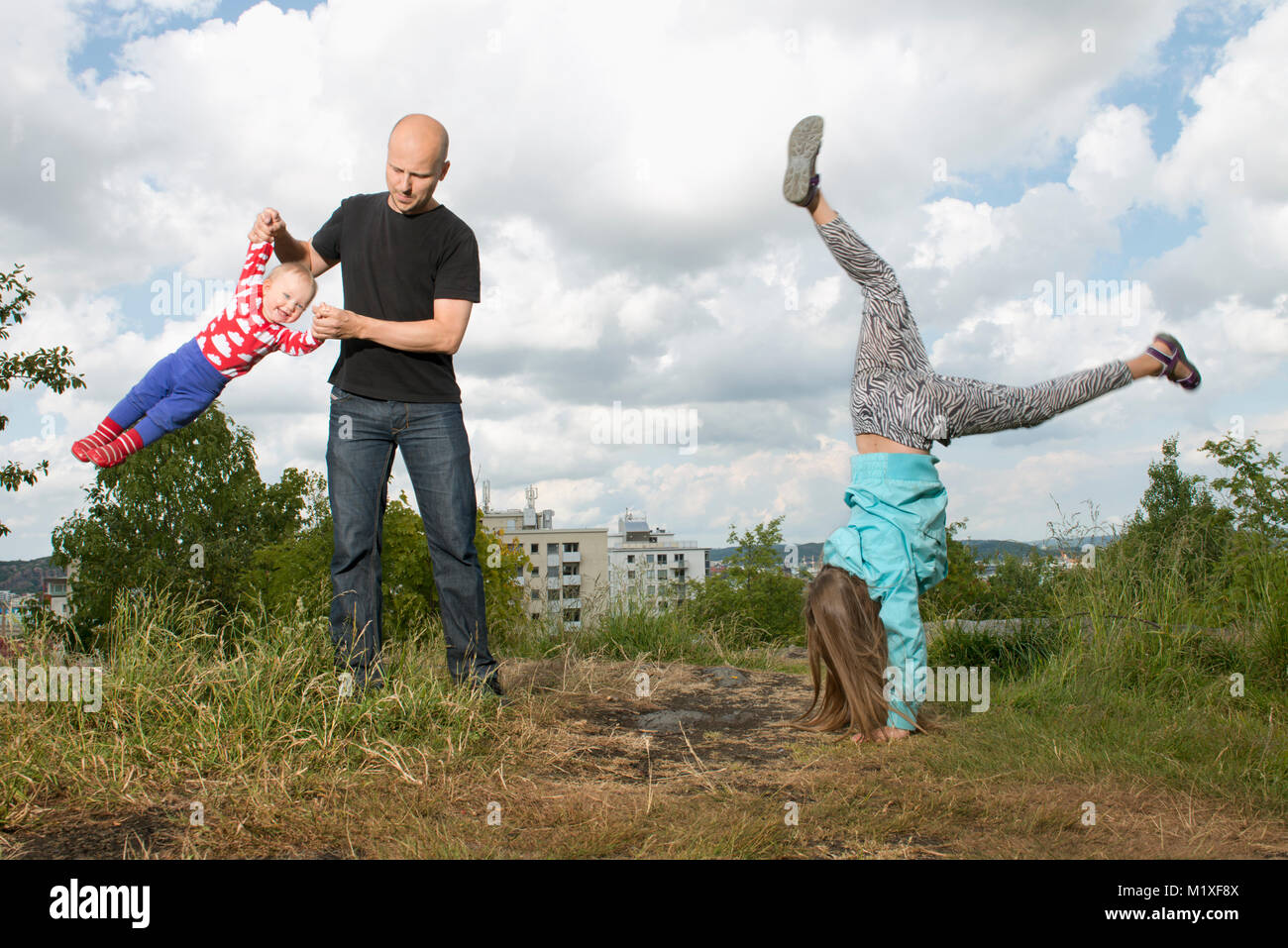 Man playing with his children in Goteborg, Sweden - Stock Image