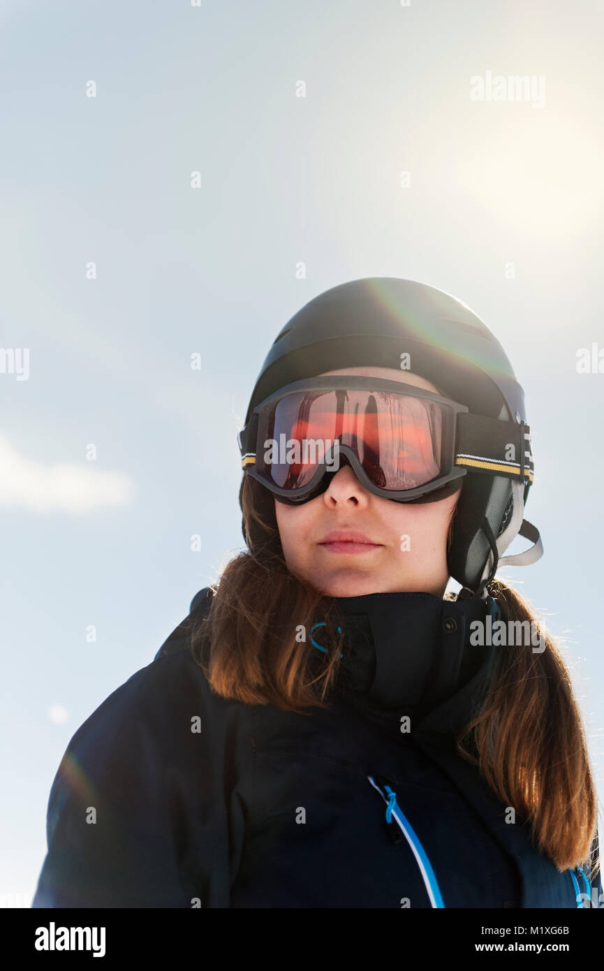 Young woman wearing ski goggles - Stock Image