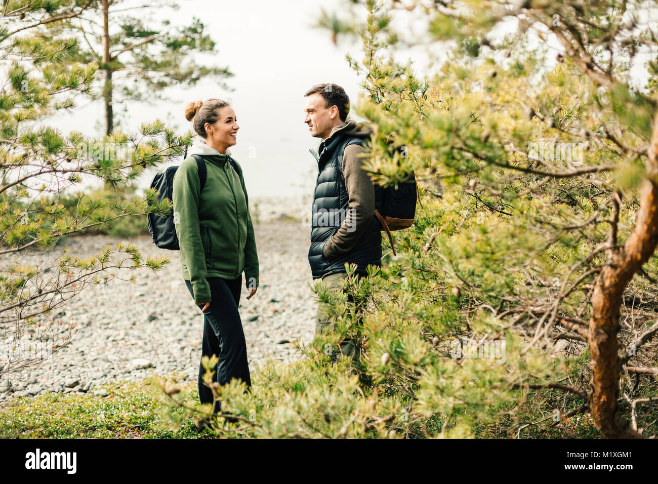 Hiking couples in Sodermanland, Sweden - Stock Image