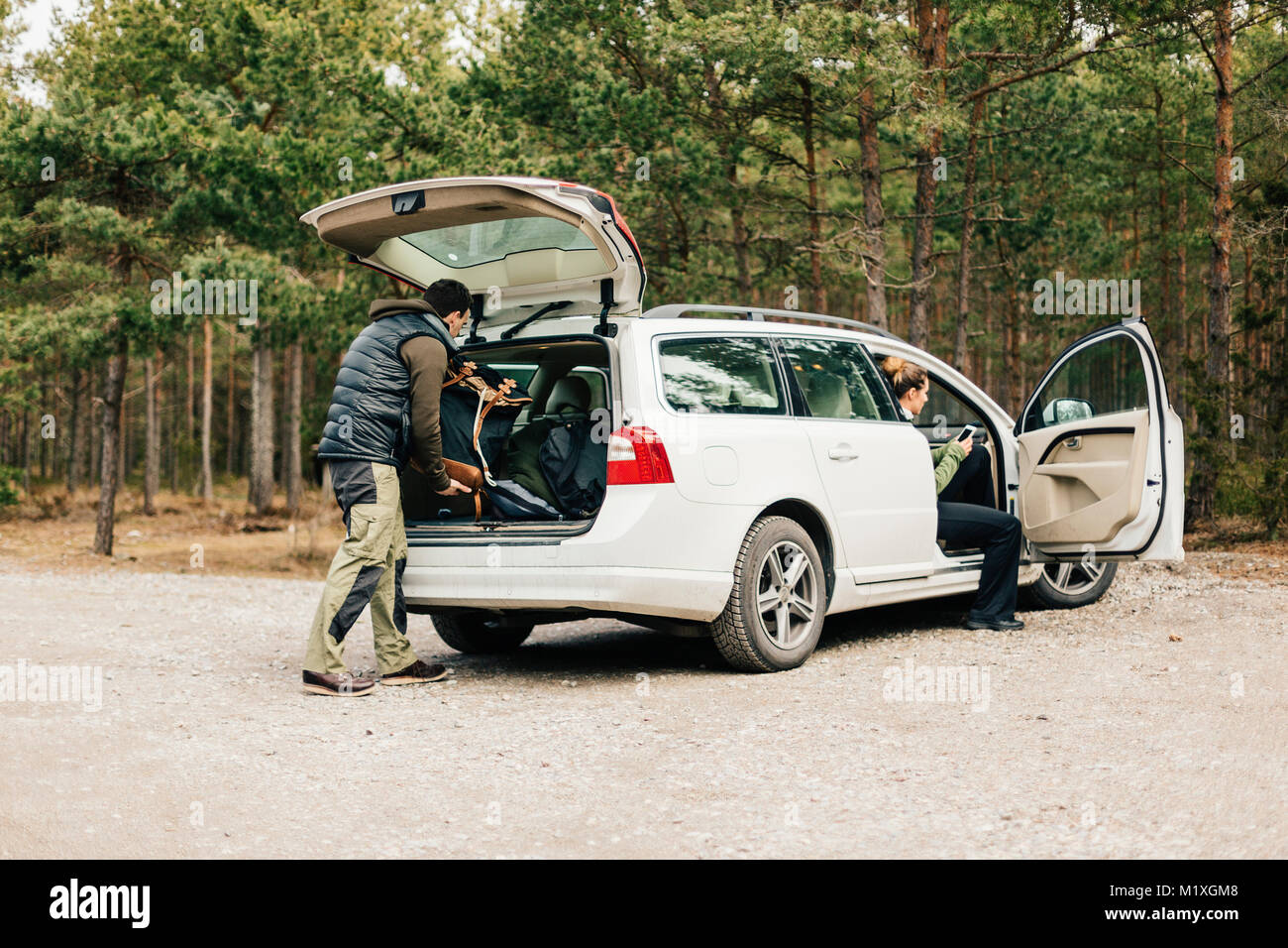 Man loading bags in car in Sodermanland, Sweden - Stock Image