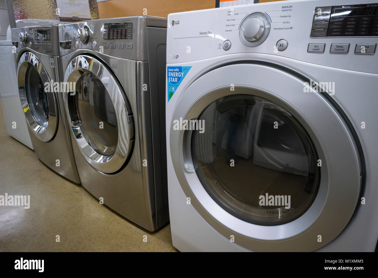 LG brand washing machines on display in a Home Depot in New York on