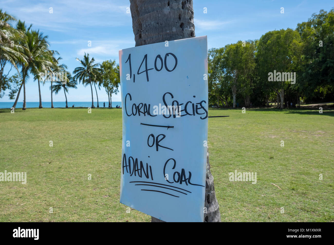 Port Douglas, sign protesting against adani coal mine and risk of damage to the great barrier reef, Queensland,Australia - Stock Image