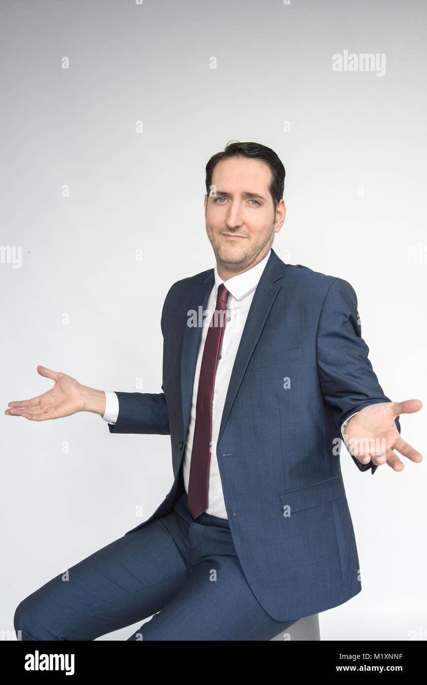A smartly dressed man conveys a range of facial and bodily emotions, portrait/isolated  on a white background - Stock Image