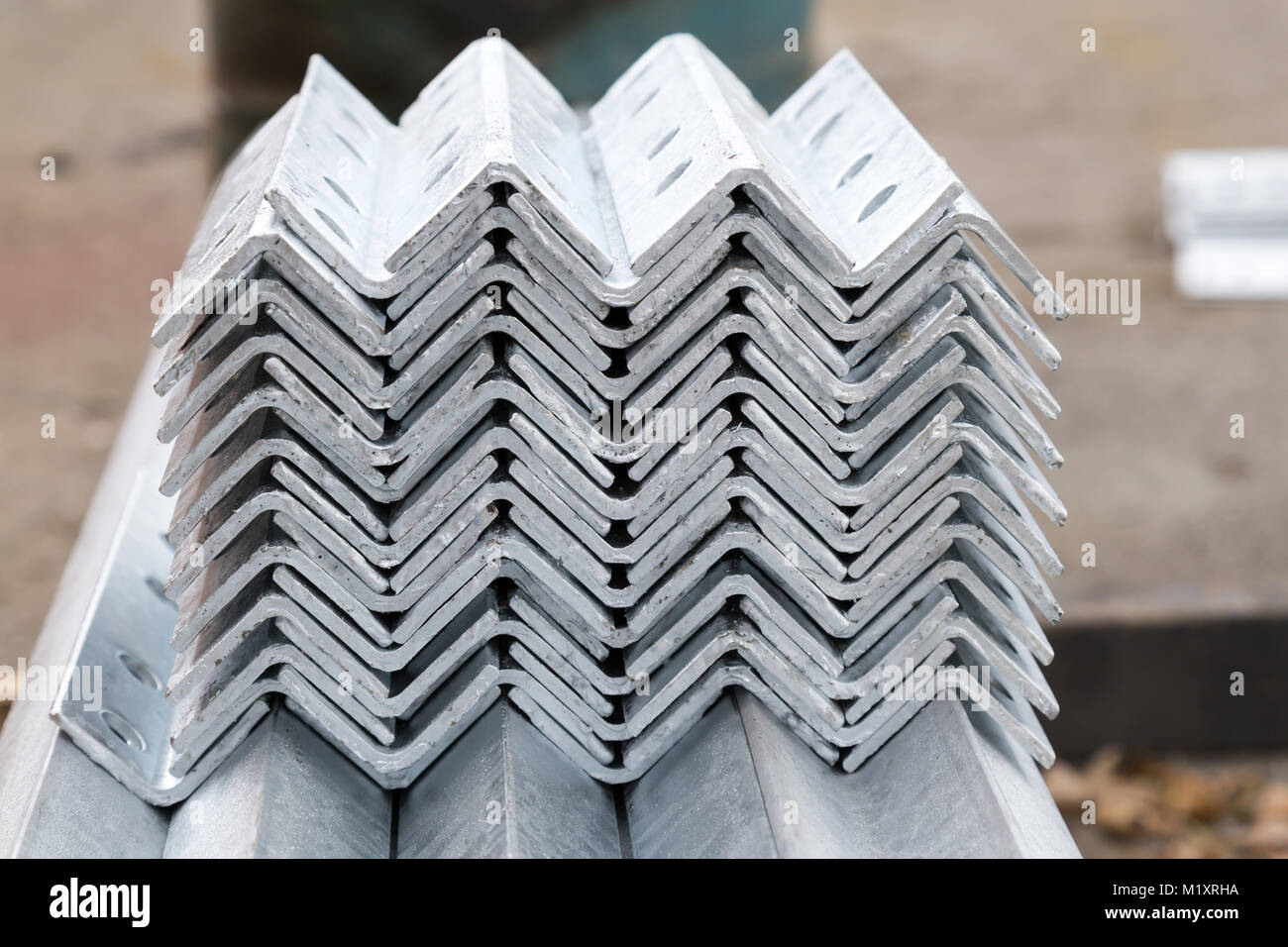 Galvanized steel material in row - Stock Image