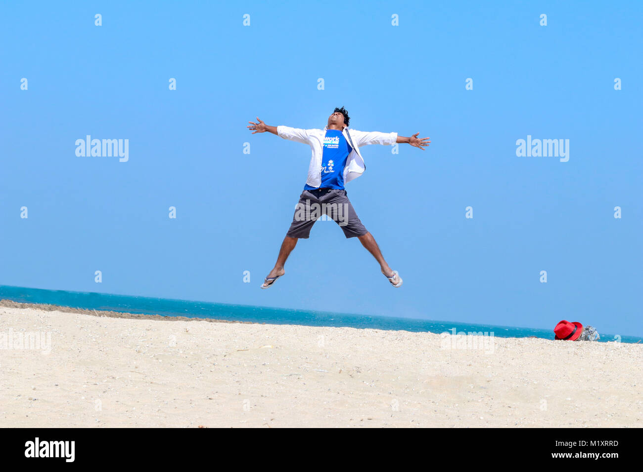 Asian Young Man Floating Mid Air With Crazy