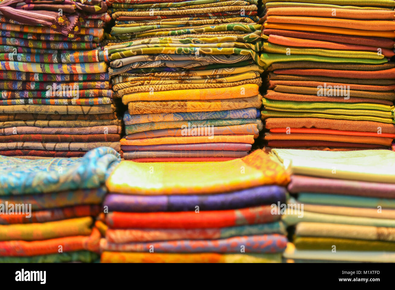 Stacked colorful Turbans for headwear, shallow depth of field - Stock Image