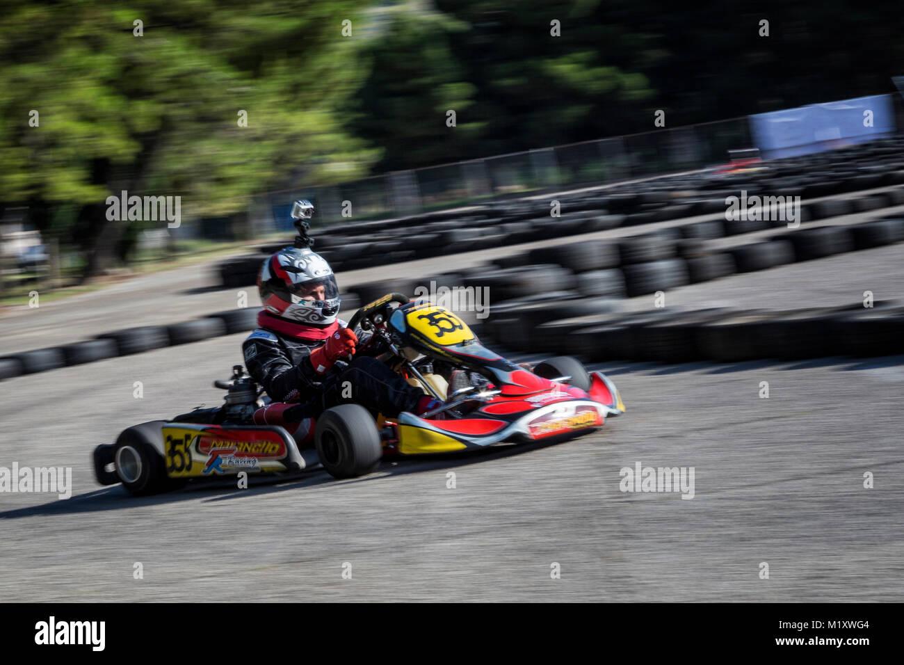Driver in Go kart participate in outdoor kart race Stock Photo