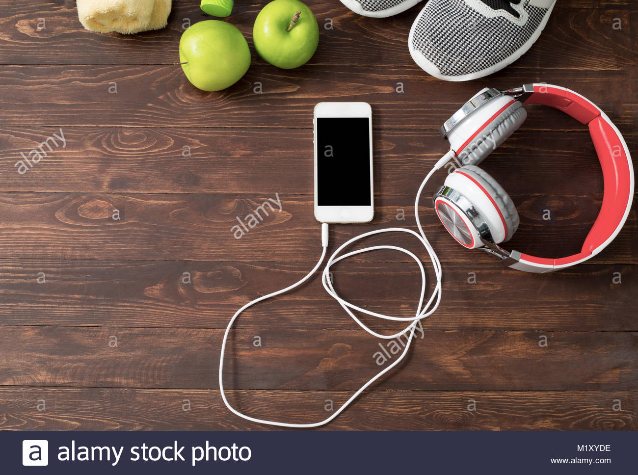 fitness concept with Exercise Equipment on wooden background. - Stock Image