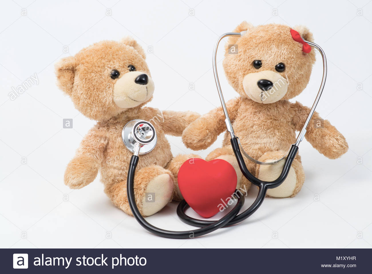 Close up Plush Teddy Bear with Stethoscope Device on Top of a Glass Table, Emphasizing Copy Space. - Stock Image