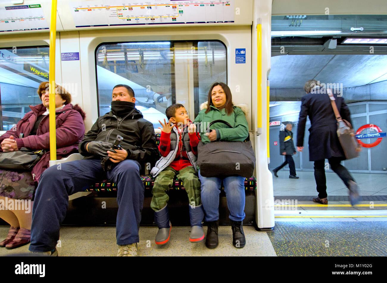 Asian Family On A Tube Train