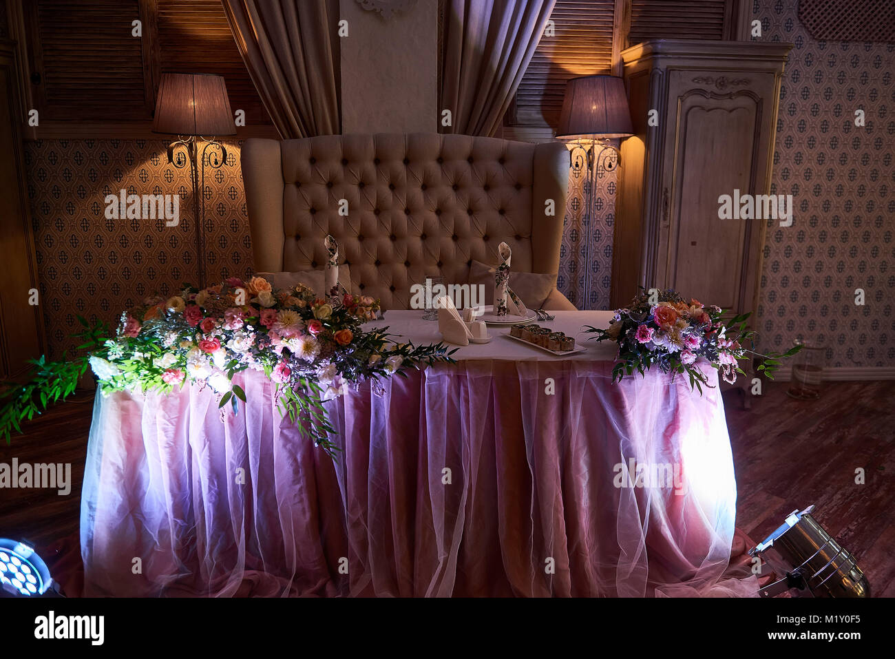 Decorated restaurant table for newlyweds - Stock Image