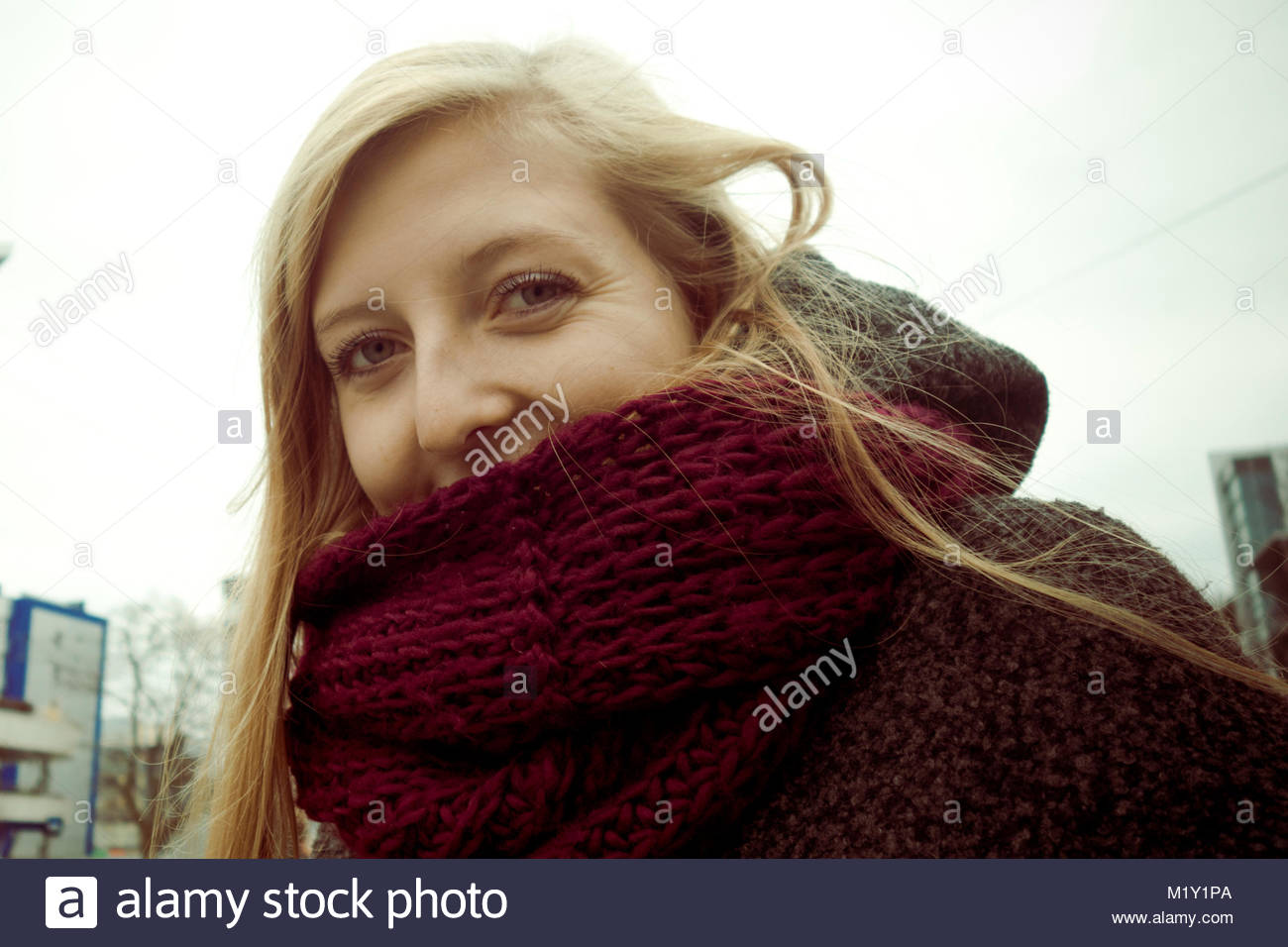 portrait of a blonde Czech young woman with a scarf, in her 20's - Stock Image