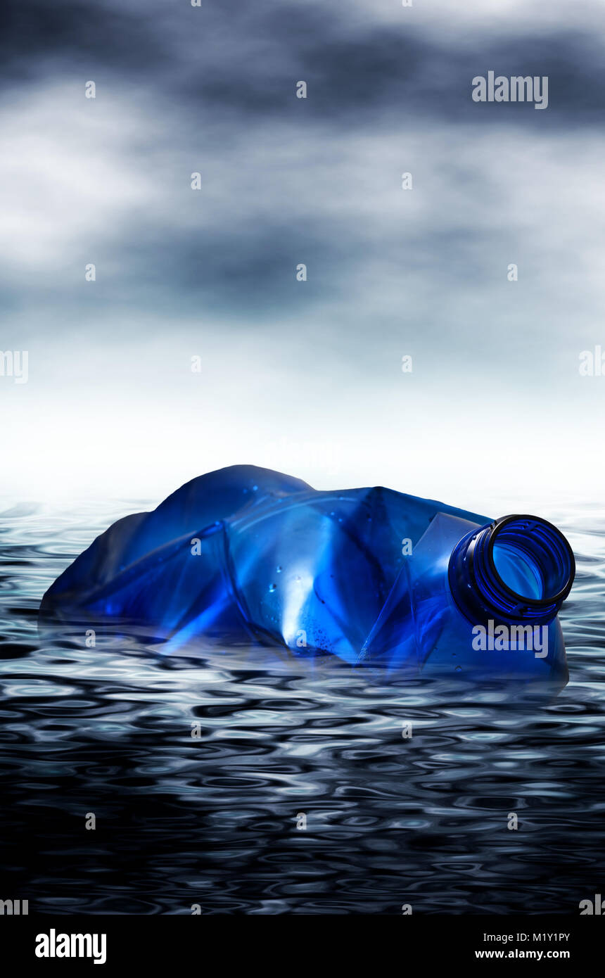 plastic bottle in the water, concept for pollution of oceans with plastic fibers that end in our tap water or fish - Stock Image