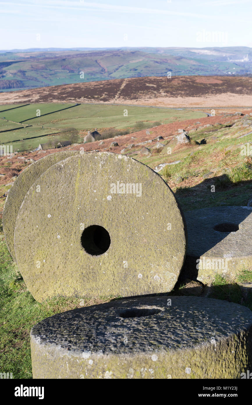UK, Derbyshire, Peak District Nationa Park, discarded millstones at Stanage Edge. - Stock Image