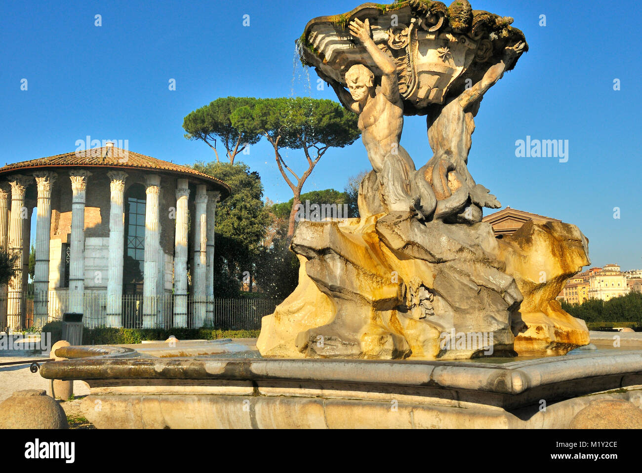 The Temple of Hercules Victor, with the Triton fountain, Rome - Stock Image