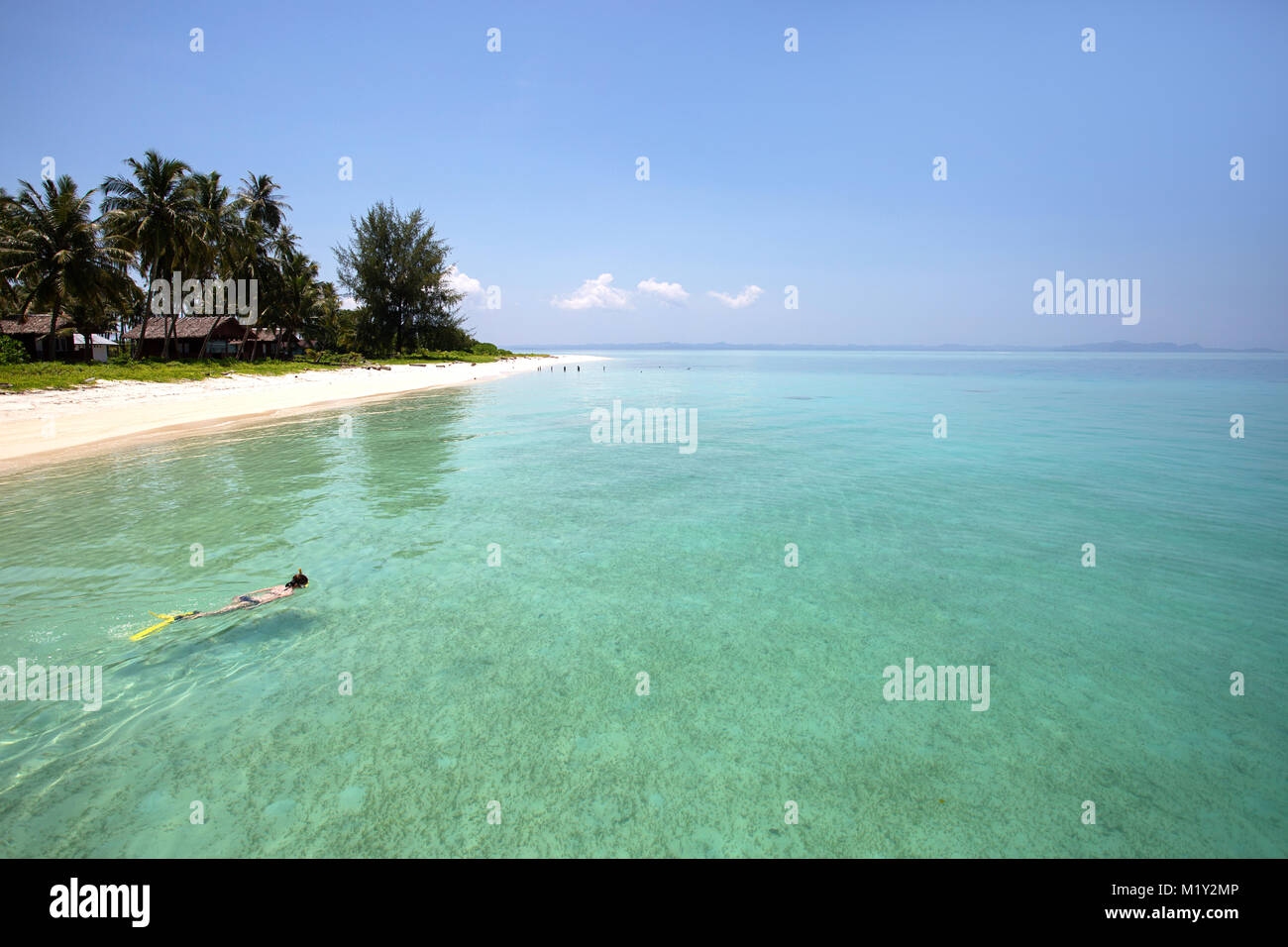 Woman snorkeling in turquoise blue sea - Stock Image