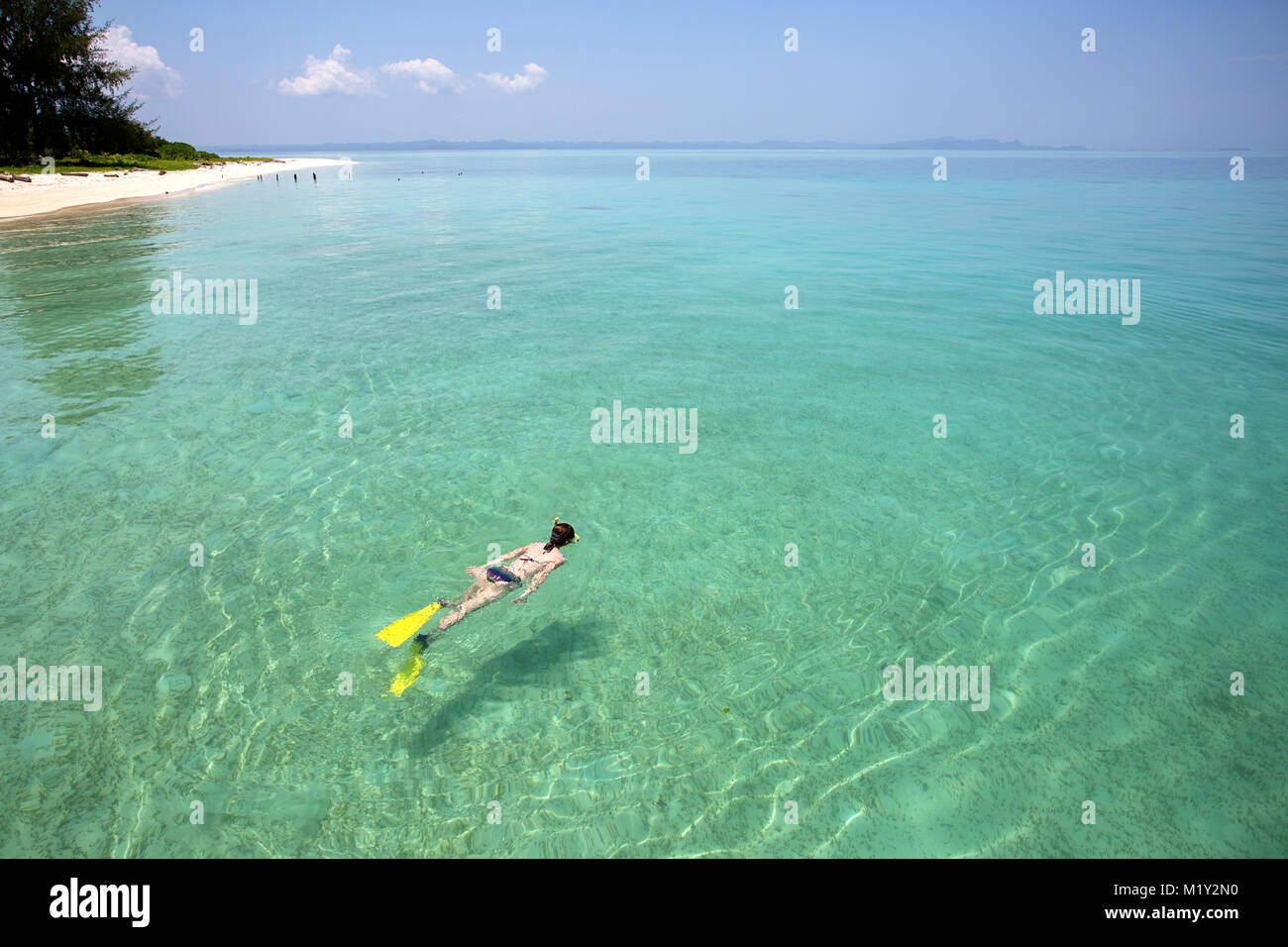 Woman snorkeling in turquoise blue sea Stock Photo