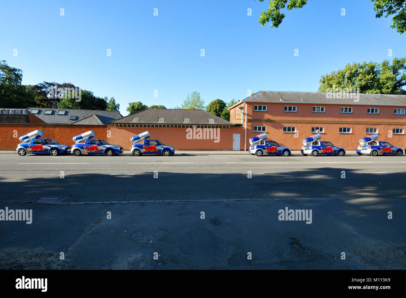 Red Bull promotional Mini cars lined up outside Royal Ascot racecourse during the Red Bull Air Race event - Stock Image