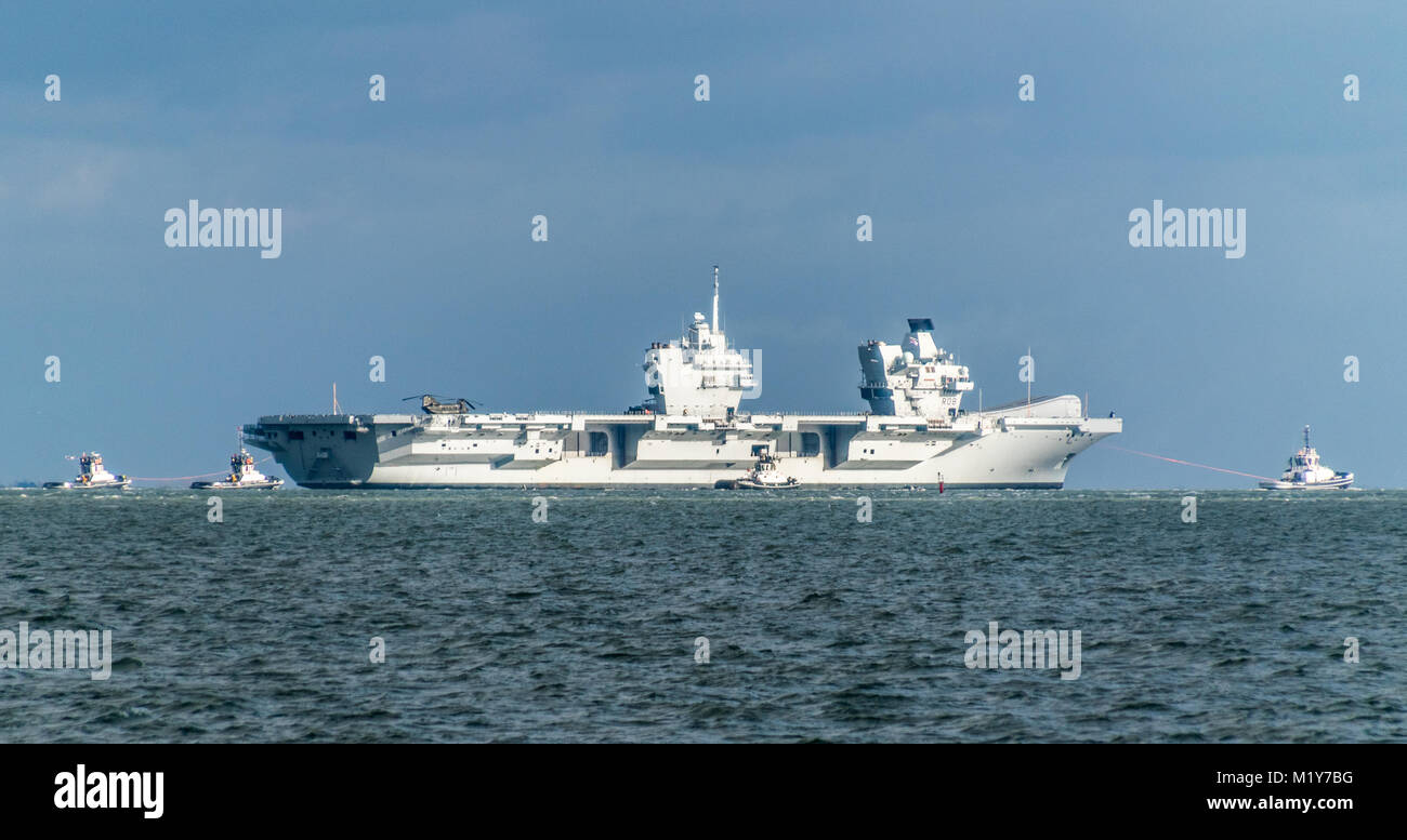 HMS Queen Elizabeth sailing through the Solent, viewed from Ryde, Isle of Wight. - Stock Image