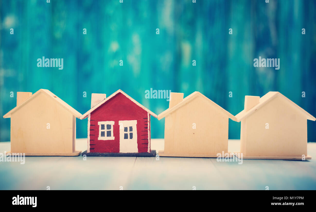 Red house on wooden background - Stock Image