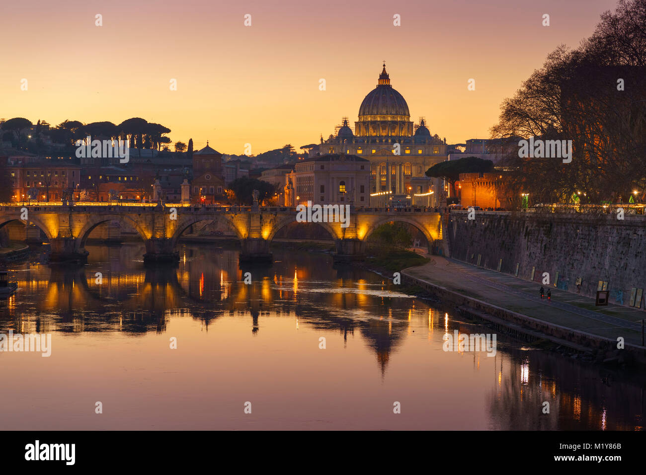 Rome Vatican St.peter basilica after sunset view of river Tiber and Saint Angelo bridge - Stock Image