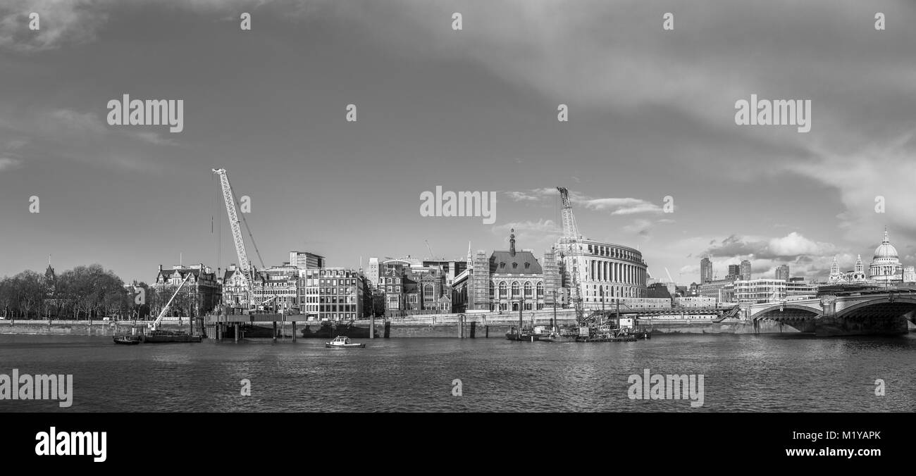 Cranes on the Blackfriars Bridge foreshore on Victoria Embankment, London working to construct the new Super Sewer - Stock Image