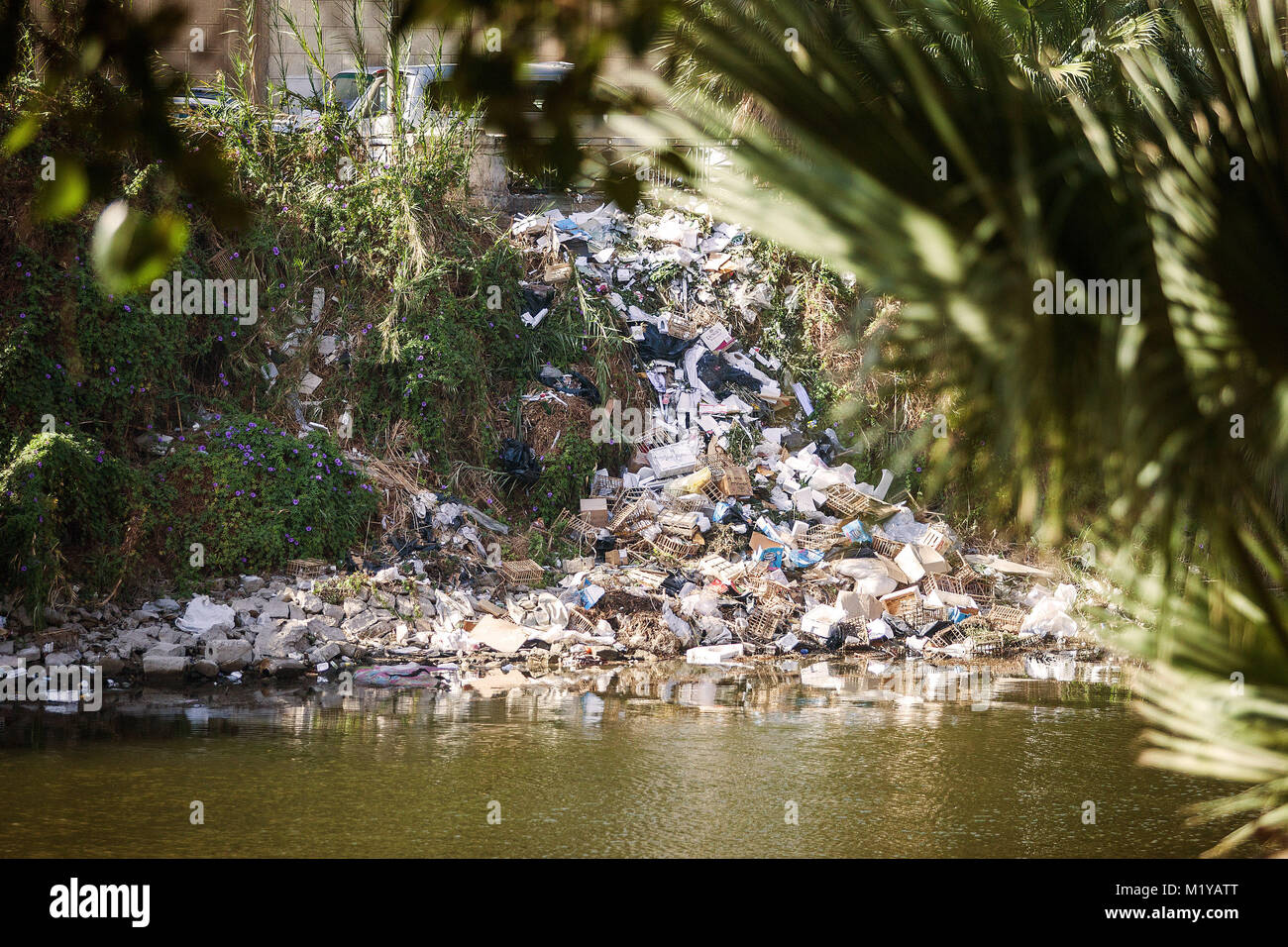 River filled with trash and plastic ecological disaster - Stock Image