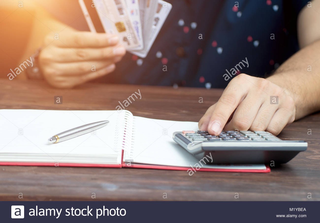 calculate how much cost or spending have with credit cards - Stock Image