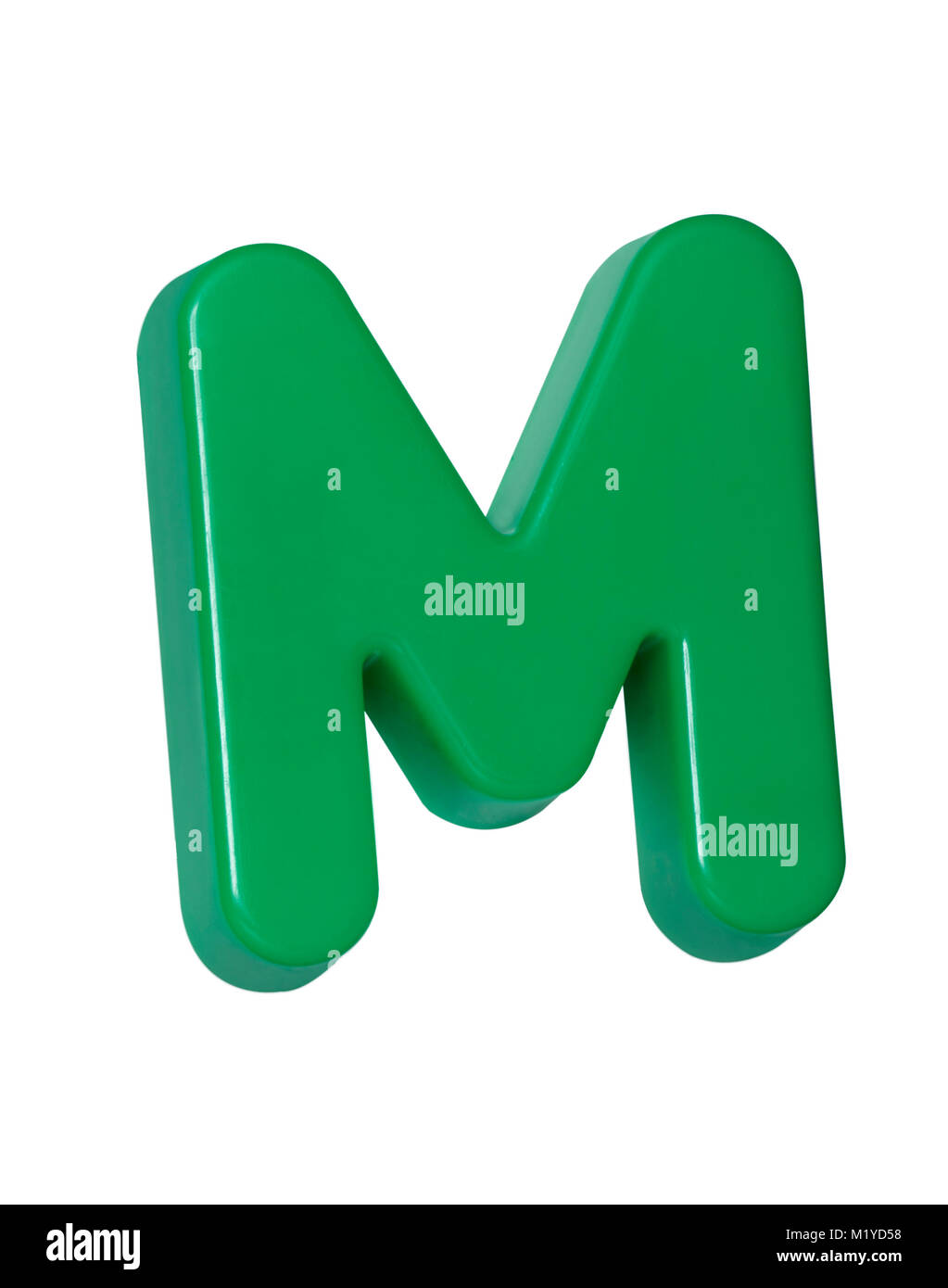 A cut out shot of a green plastic letter 'M' - Stock Image