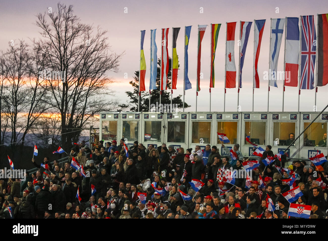 ZAGREB, CROATIA - JANUARY 4, 2018 : Croatian fans with flags during the Audi FIS Alpine Ski World Cup Mens Slalom, - Stock Image